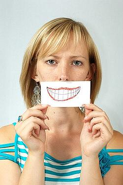 Woman with fake smile