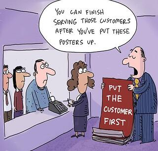Cartoon showing the irony of business who say they put their customers first, but in reality, don't.