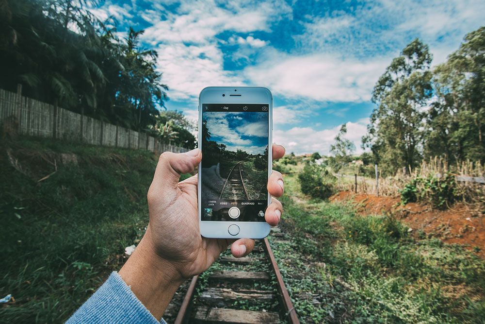 A 'bigger picture' photo of a smartphone taking a photo