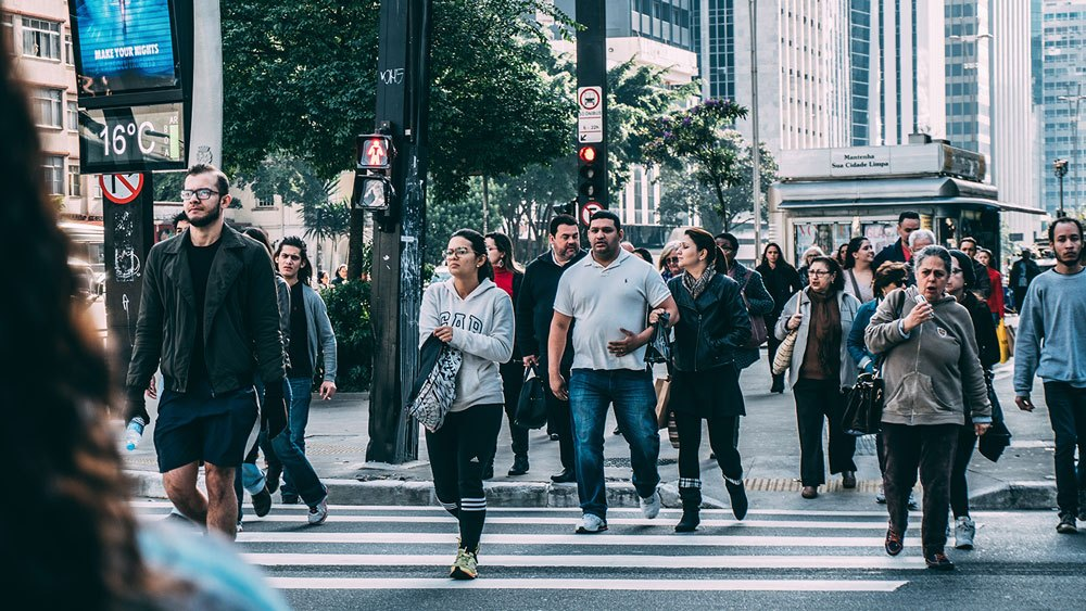 A crowd of people crossing the road